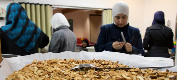 syrian-refugee-women-mount-pleasant-neighbourhood-house-food-prep-nuts